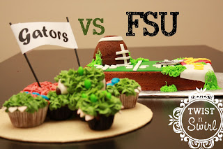 A green alligator cupcakes behind football field cake