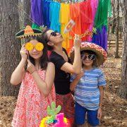 pinata, cinco de mayo, diy garland, rainbow backdrop, rainbow garland, dessert table, photobooth